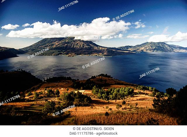 View of Lake Atitlan, with the Atitlan volcanoes in the background, Toliman and San Pedro, Guatemala