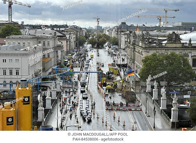 A motorcade accompanying the royal couple of Sweden makes its way from the Brandenburg Gate (C) over the Unter den Linden boulevard in Berlin, Germany
