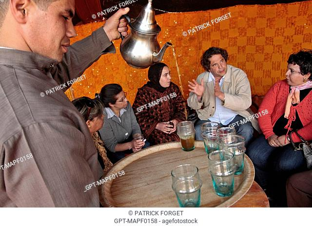 JEAN-MARTIN HERBECQ, FOUNDER AND DIRECTOR OF THE TERRES D'AMANAR NATURE PARK, WITH WOMEN OF THE VILLAGE, TAHANAOUTE, AL HAOUZ, MOROCCO