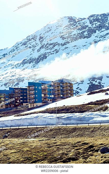 View of apartment buildings on snow covered mountain