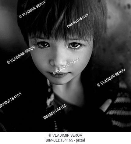 Close up of sad Caucasian girl looking up