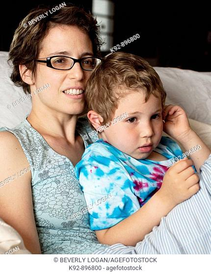 Mother and son watching television