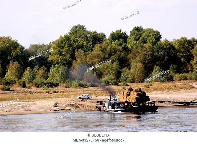 Russia, waterway of Akhtubinsk - Astrakhan, hay bale on ferryboat on the West shore of the Volga