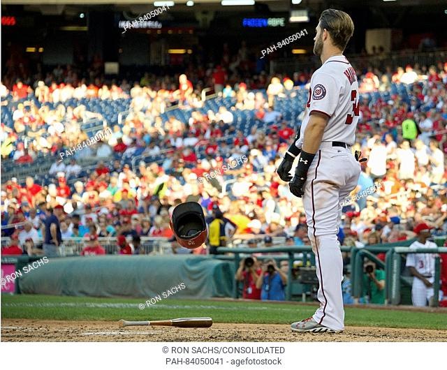 Washington Nationals right fielder Bryce Harper (34) throws hit helmet in disgust after being called out on strikes to end the sixth inning against the New York...