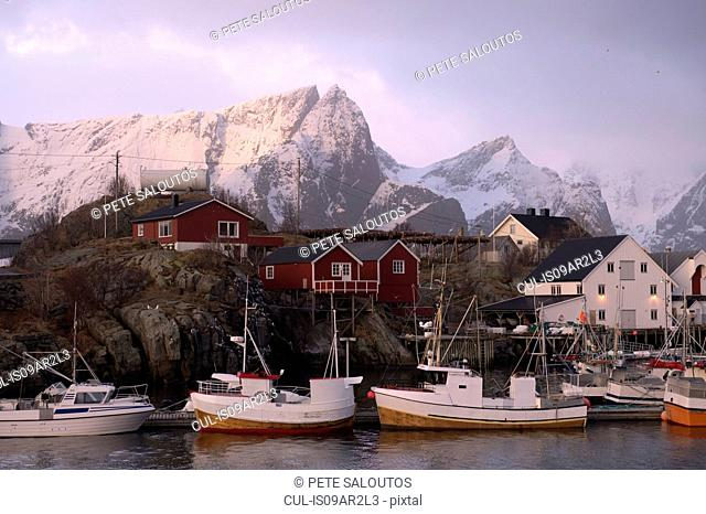Reine fishing village with snow capped mountains, Norway