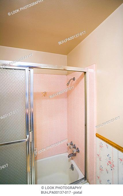 Small bathroom with a pink shower