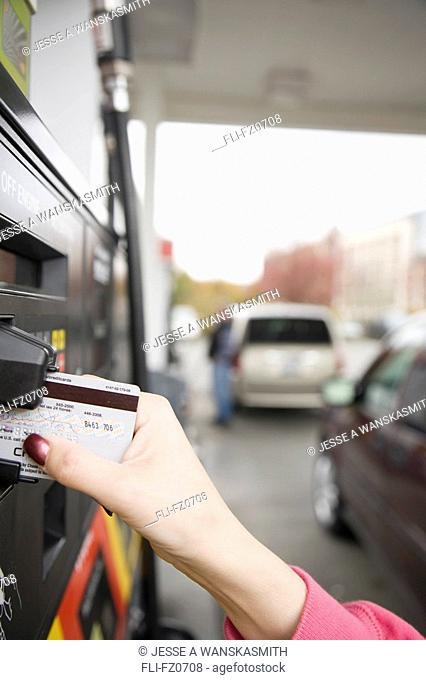 Paying for fuel with a credit card, Bellevue, Washington