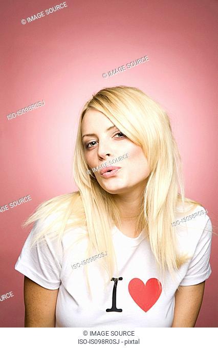 A young woman pouting