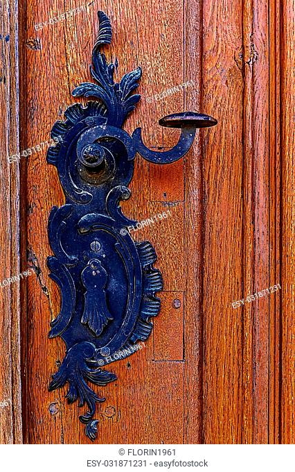 Detail of a medieval wooden door with ornamental knob