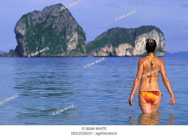 A Woman Tourist Wearing A Bikini Enjoys The Sunshine On The Tropical Island Of Koh Ngai Or Ko Ngai Near Trang, Koh Ngai Thailand