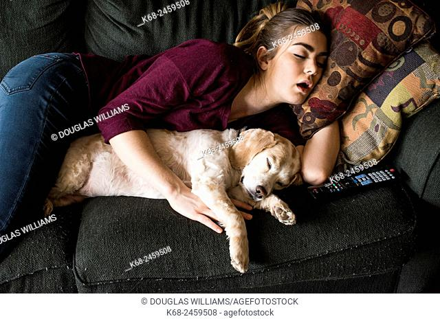 young woman, 19, sleeping with her spaniel