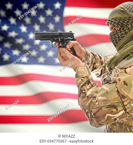 Male with gun in hand and national flag on background series - United States