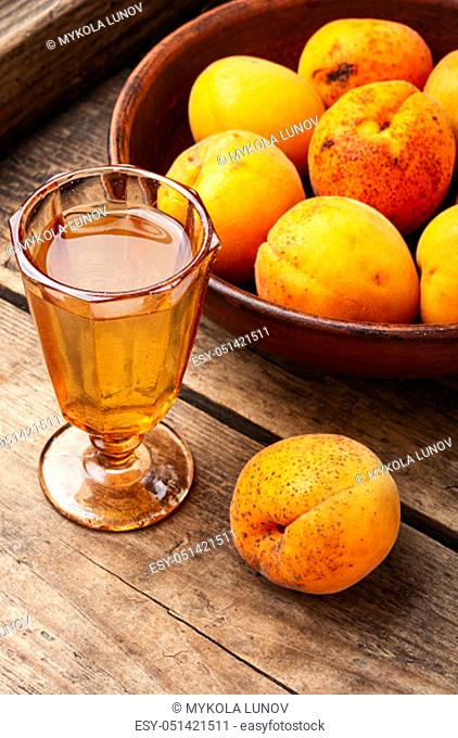 Ripe apricot wine.Alcoholic drink.Fruit wine or liquor in glass