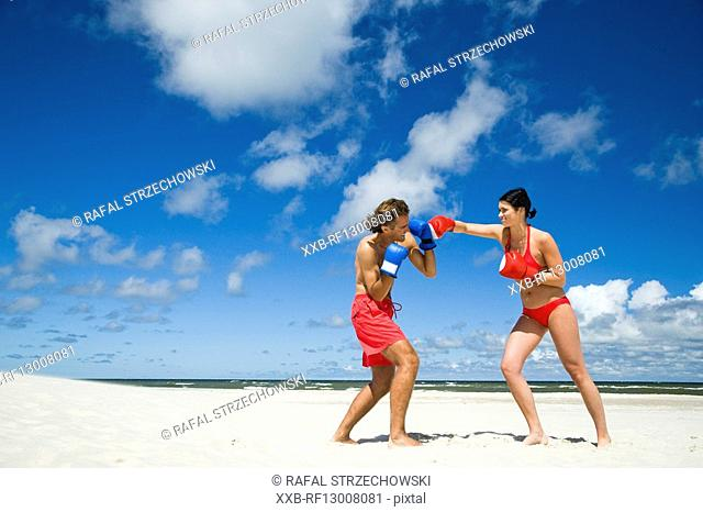 couple boxing on beach