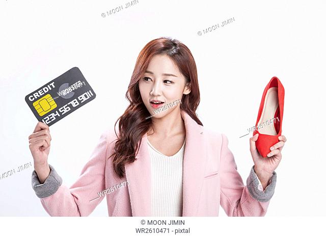Woman with credit card and shoe