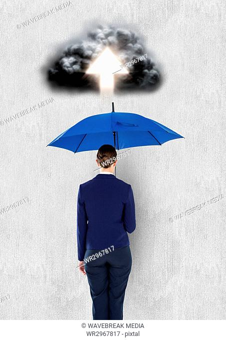 Digital composite image of cloud with arrow over businesswoman holding blue umbrella