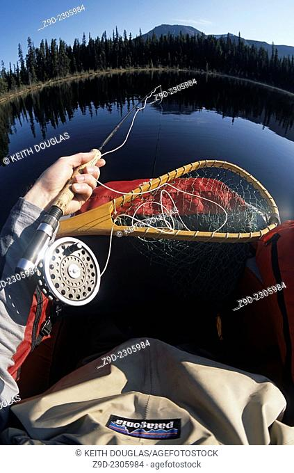 Flyfishing for trout from float tube, Llama lake, Smithers, BC