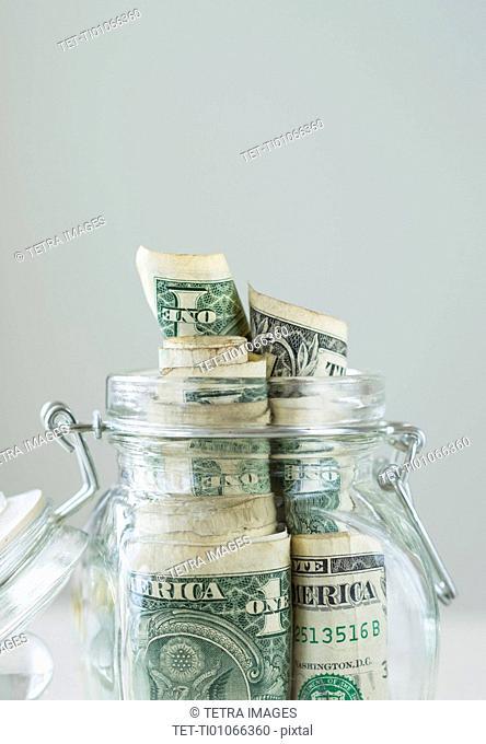 Studio shot of savings in jar