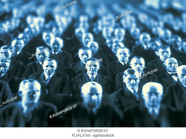 Men sitting in auditorium