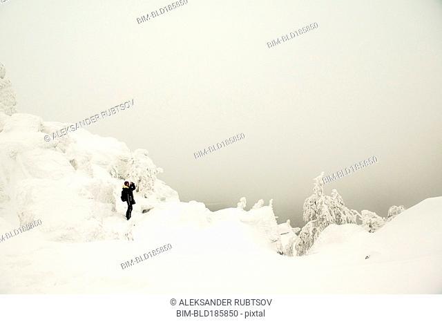 Hiker walking in snowy forest