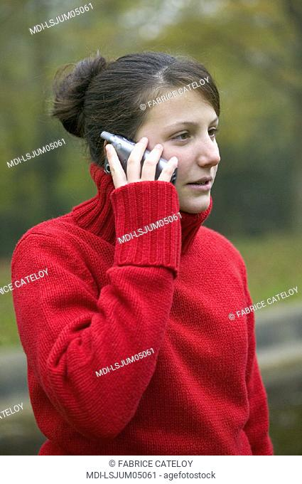 Portrait of a teenager calling with a mobile phone