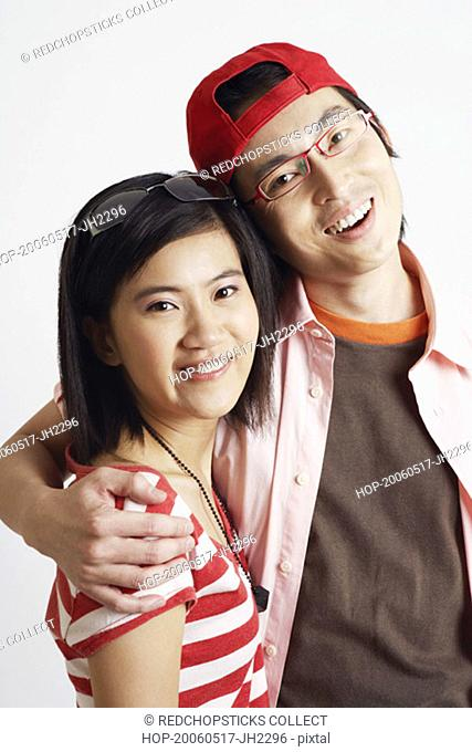 Portrait of a young woman and a mid adult man smiling