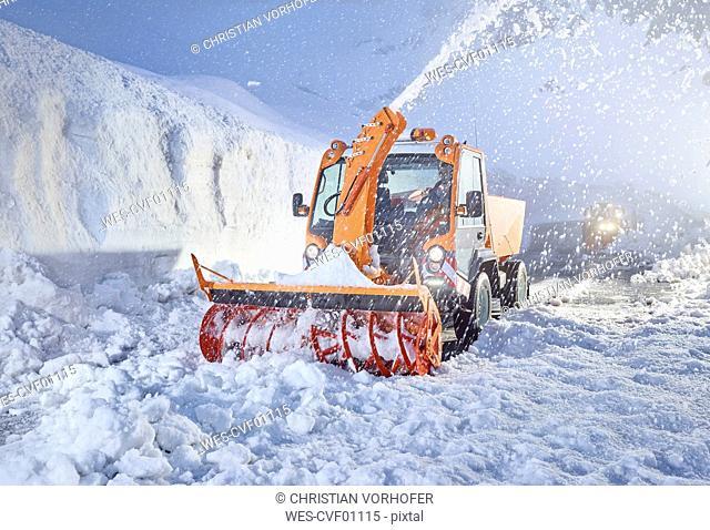 Austria, Tyrol, Hochgurgl, snow-plowing service with snowblower