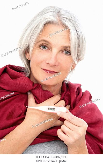 Woman holding thermometer