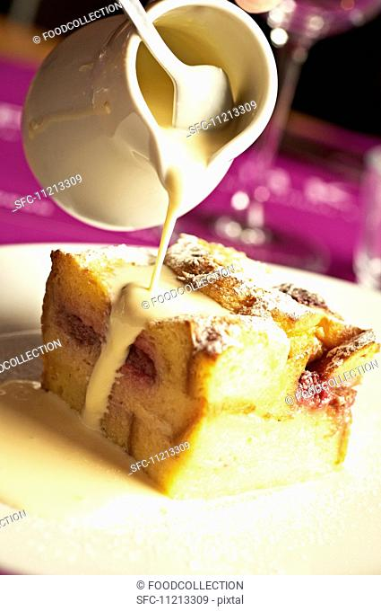 Baked strawberry pudding with custard