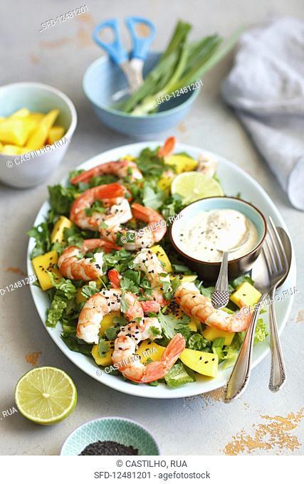 Salad with mango and prawns, cream mayo sauce