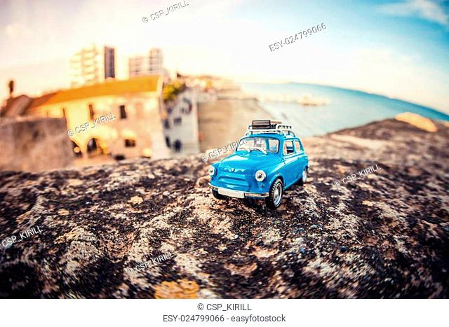 Miniature travelling car with luggage on a roof