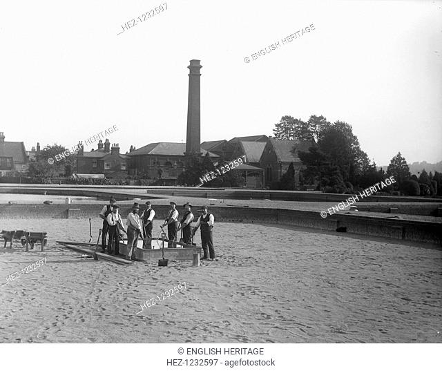 Oxford Waterworks, Oxford, Oxfordshire, 1914. Men washing sand in the base of a dry filter bed at the sewage treatment works