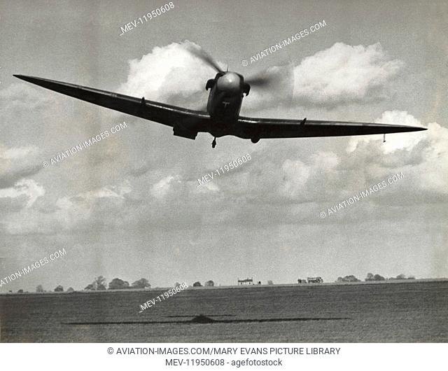 US Army Air Corps Supermarine Spitfire Flying at Low-Level over an Airfield Playing an Attacking Luftwaffe Aircraft