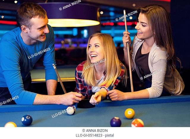 Fun with friends during playing billiard. Rzeszow, Poland