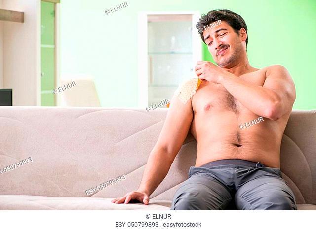Man applying pepper Capsicum plaster to relieve pain
