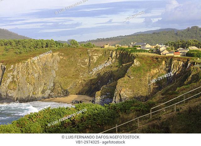Cliffs over O Picon village and beach in high tide, Coruna province, Galicia, Spain, Europe