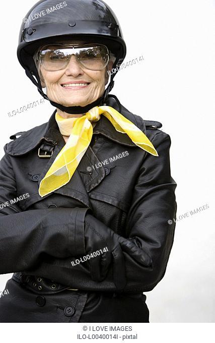 A senior woman wearing a helmet