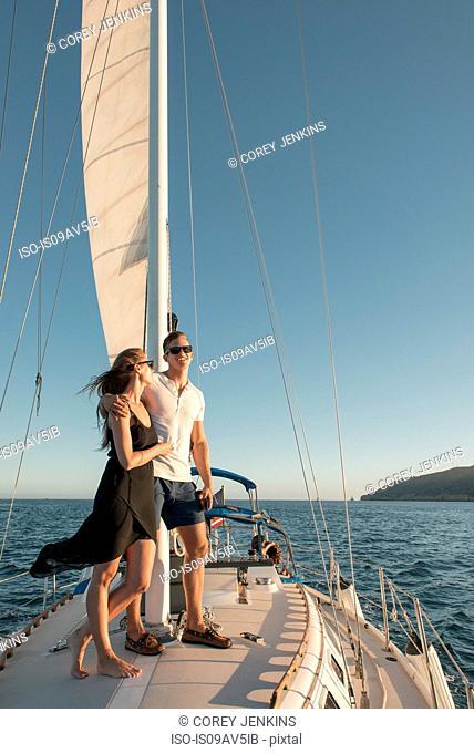 Couple enjoying view on sailboat, San Diego Bay, California, USA