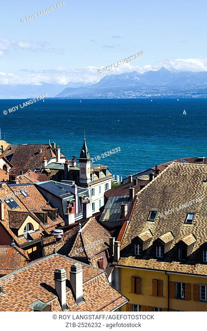 View over the rooftops of Nyon in Switzerland, looking across Lake Geneva towards the French Alps