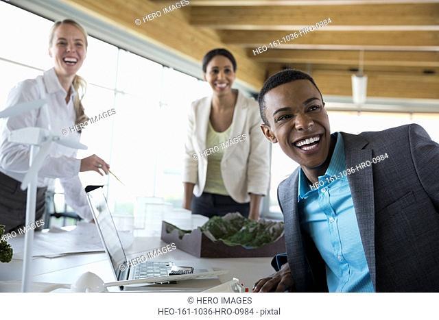 Group of cheerful energy engineers