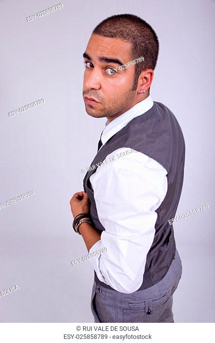 young business man pensive, on a grey background