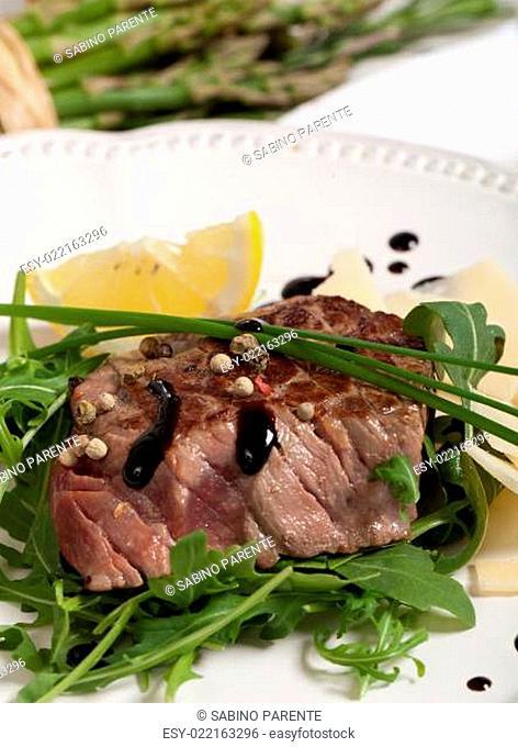 Beef on arugula salad and parmesan