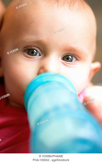 7 months old baby with feeding bottle