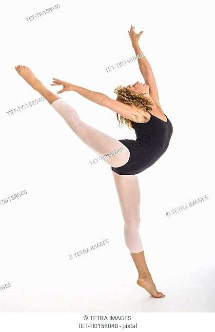 Female ballet dancer during practicing, studio shot