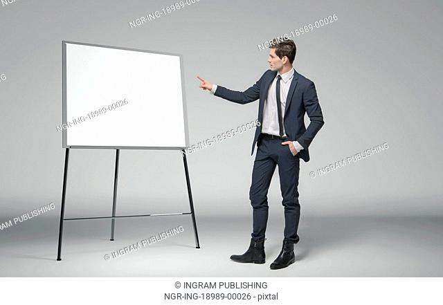 Young man making a lecture about business