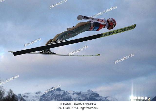 Severin Freund of Germany soars through the air during a training session of the the fourth stage of the Four Hills ski jumping tournament in Bischofshofen