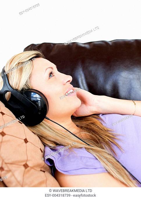 Cute woman using headphones