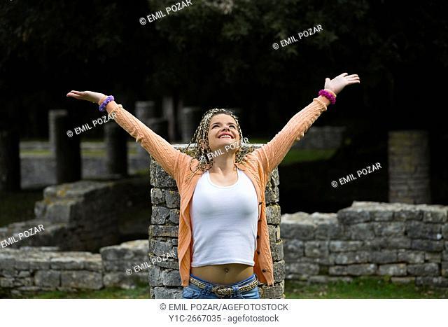 Young woman joyful happy spread arms