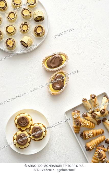 Various biscuits and confectionery on a white background