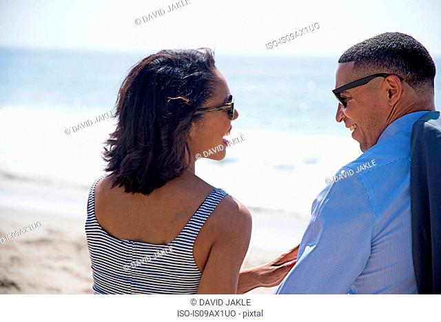 Couple chatting on beach